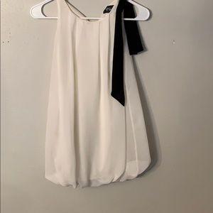 Little girls cream colored dress black bowtie